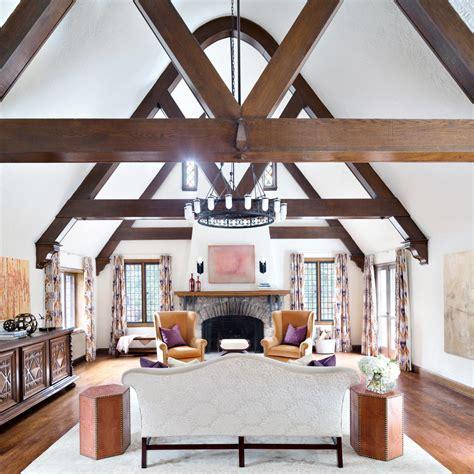 great room  hotel inspired chandelier wood beams hgtv