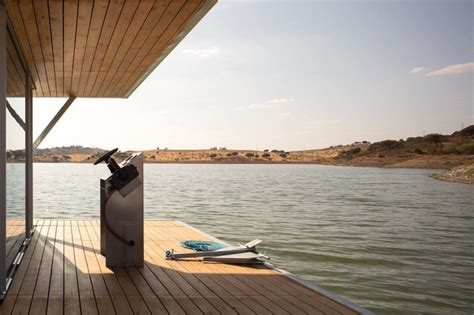 friday floatwing solar powered floating home in portugal generates a year s
