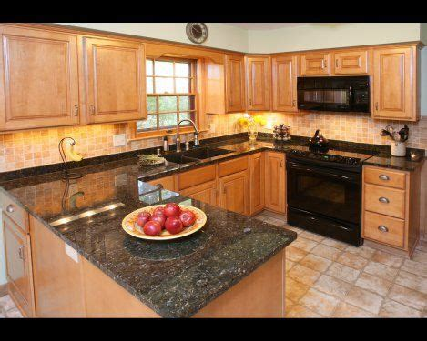 backsplash ideas for black granite countertops and maple cabinets 37 best granite countertops with oak cabinets images on