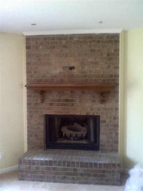 Renovating Brick Fireplace by Brick Fireplace Painting And Renovation High Heels To