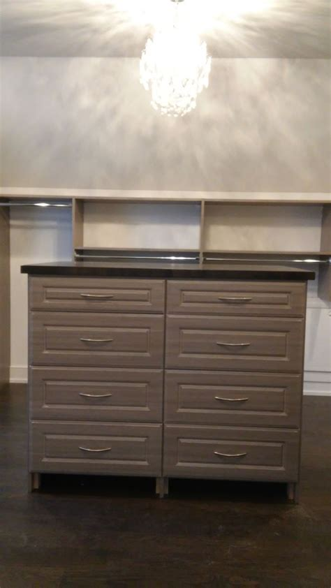 laminate island in master closet with drawers and