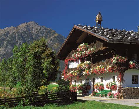 traditional tyrolean house st johann in tirol tirol st moritz to innsbruck bike tour austria switzerland