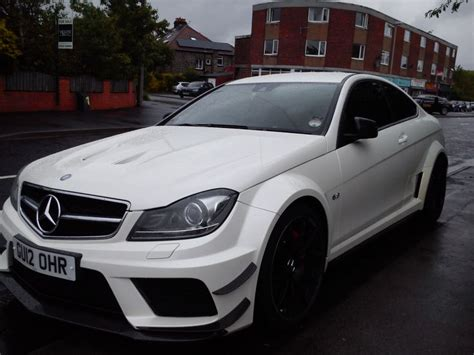 white bentley black rims mercedes c63 amg black series in white with black