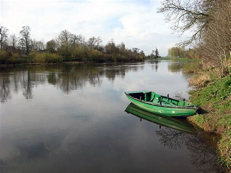 the boat on the river a rowing boat on the river tweed 169 walter baxter cc by sa