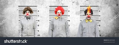 How To Look Up Criminal Charges A And Two Clowns Who Criminal Charges Lineup Against A Cement Wall In