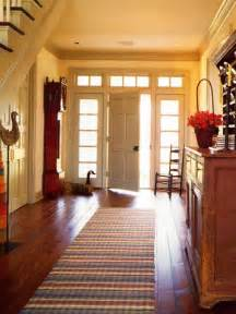 spacious entryway ideas with wooden foyer cabinet storage