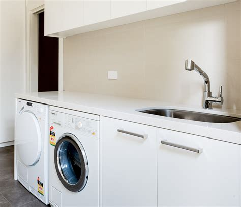Living Room Space Saving Ideas - contour cabinets laundry designs