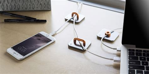 keep cables on desk 11 creative cable holders that stop the cables falling
