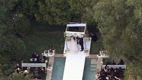 wedding aisle pool shannen doherty wedding pictures popsugar