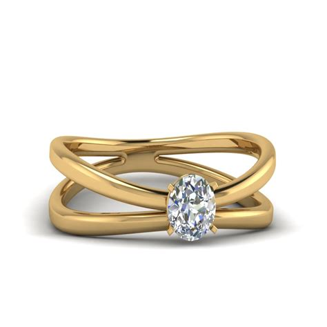 oval shaped reversed split solitaire engagement