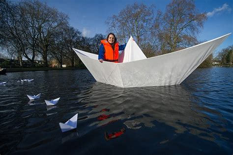 origami boat real origami boat made from paper carries adult across lake