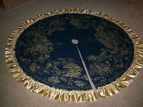 navy blue and gold christmas tree skirt with gold ruffle