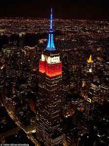 empire state colors empire state building lit up white and blue after usa