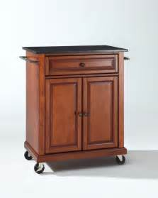 Solid black granite top portable kitchen cart island in classic cherry