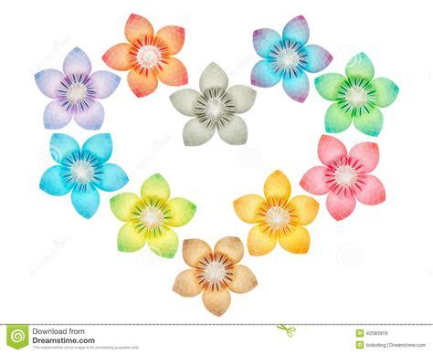 Paper Folded Flowers - paper folded flowers arranged in a shape stock