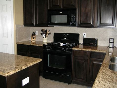 kitchen backsplash with oak cabinets and black appliances black appliances with java cabinets kitchen pinterest