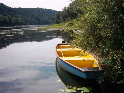 the boat on the river free boat on the river bank stock photo freeimages