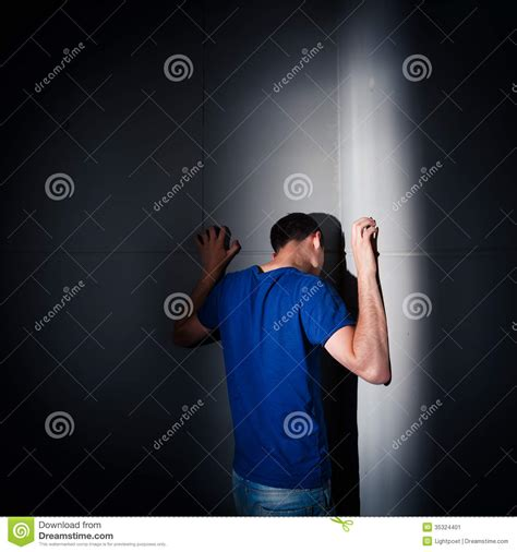 harsh lighting young man suffering from a severe depression anxiety