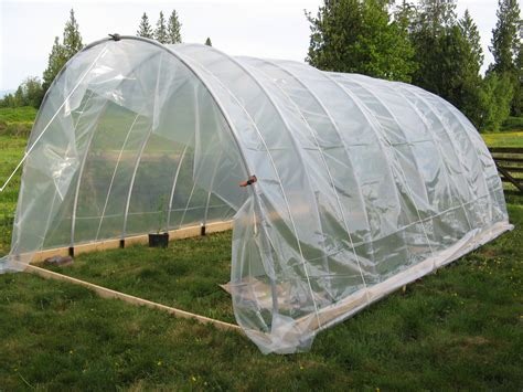 hoop house putting plastic on hoop house meanwhile in the country