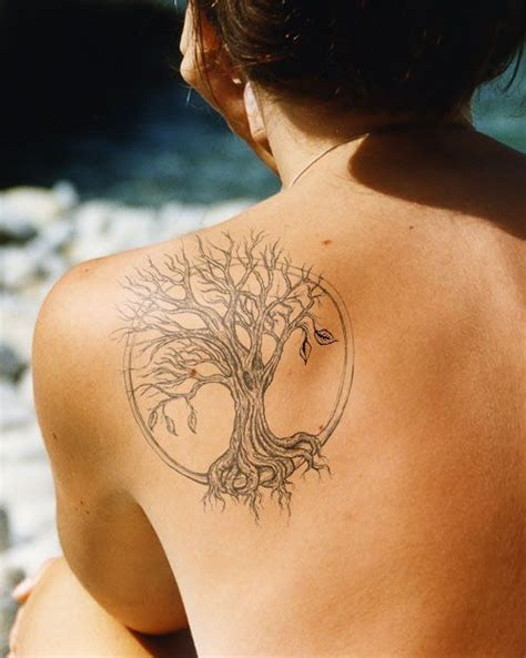 tattoo ideas for your shoulder blade butterfly tree flying bird lily flower shoulder blade
