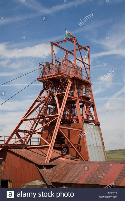 Big Pit Headframe And Winding Wheel With Flag Flying At Big