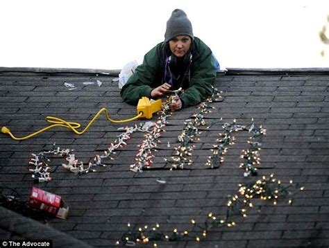 putting christmas lights on roof childs gives the middle finger once again daily mail