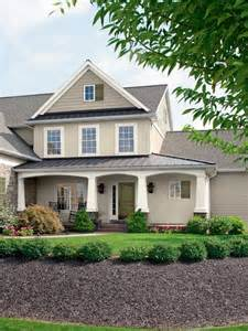 superior Grey And Yellow Dining Room Ideas #6: cream-wall-modern-house-paint-exterior-with-white-pole-can-add-the-elegant-touch-of-the-house-design-ideas-it-also-has-green-yard-in-front-of-the-house-825x1100.jpeg
