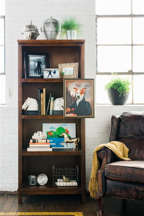 how to style a bookcase how to style a bookshelf bookshelf styling tips one