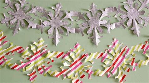 How To Make A Paper Chain Of Snowflakes - how to make paper snowflake chains