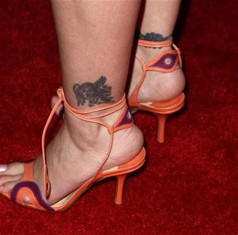 alyssa milano s 7 tattoos meanings steal her style alyssa milano tattoos pictures images pics photos of her