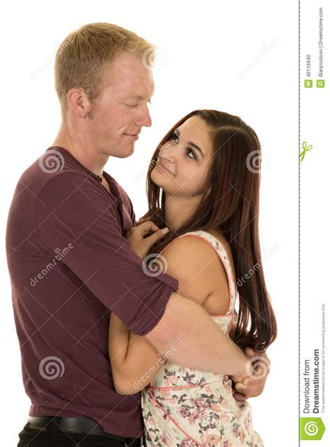 what men love in women insight into his mind man arms around a woman look at each other stock photo