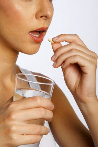 Taking A by Taking Pill With Water Premium Q10 Capsules