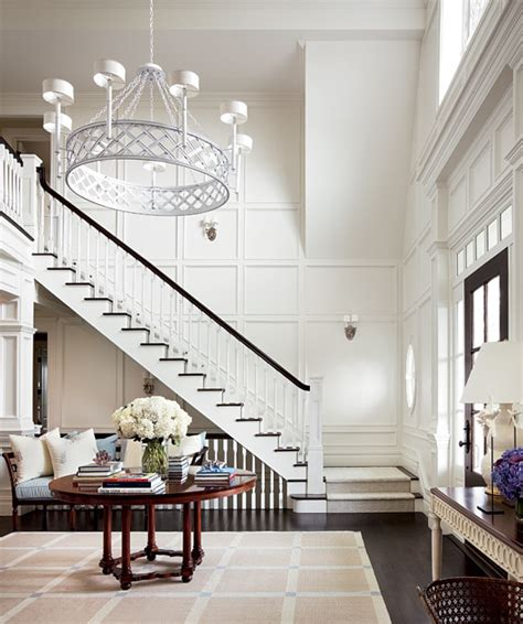 entryway stairs floor to ceiling wainscoting transitional entrance foyer architectural digest