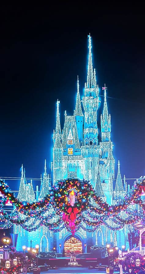 christmas disney magic kingdom castle with the wreaths