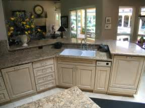 Kitchen island with raised dishwasher prep sink placement in island