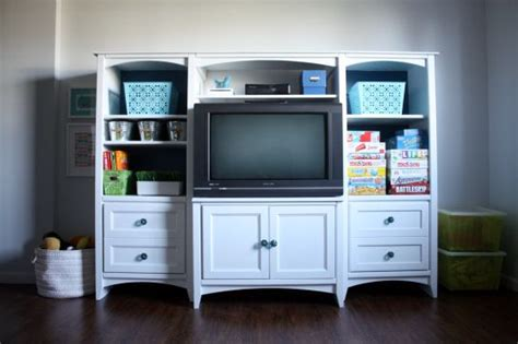 entertainment center makeover on pinterest painting oak a good tutorial on painting wood furniture thinking about