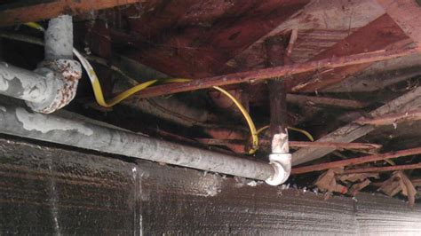 Basement Finishing Johns Creek by Pipes Rusting Under The House