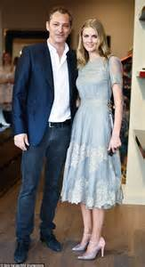 donna air hops across in blue lace dress and