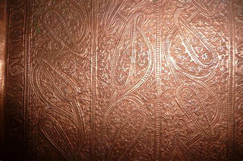 hammered copper sheet for backsplash bathroom remodel