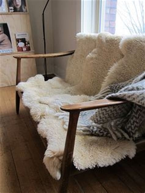 sheepskin rug on chair 1000 images about sheepskins on sheepskin rug sheep and fur throw