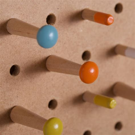 white pegboard with wooden pegs small by block design pegboard with wooden pegs medium by block
