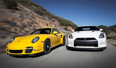 Gtr Vs Porsche Turbo by Nissan Gt R Black Edition Vs Porsche 911 Turbo S 2