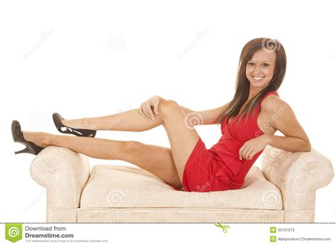 facesitting on sofa woman red dress sit side couch stock photos image 33137973