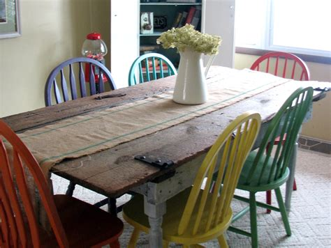 turning an old door into a dining room table remodelaholic old barn door recycled into kitchen table