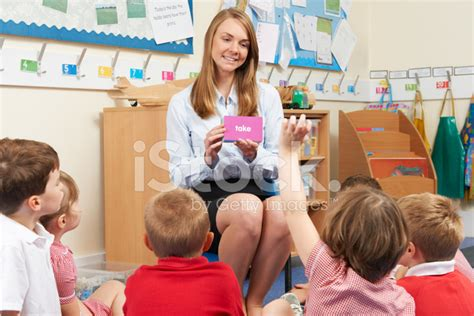 teacher flashes students teacher showing flash cards to elementary school class