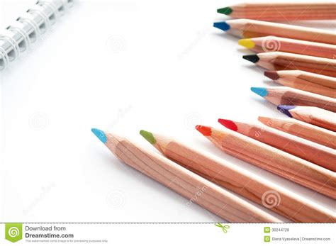 sketchbook and pencils colored pencils and sketch pad royalty free stock photos