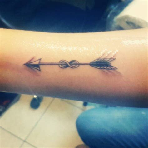 arrow infinity tattoo forearm of an arrow crossing the infinity symbol on