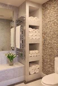bathroom shelving and storage organizing and storing bathroom towels 3 ways and 18