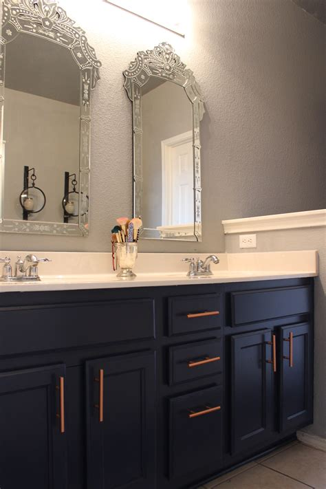 navy blue cabinet pulls navy cabinets copper hardware pulls venetian style mirrors