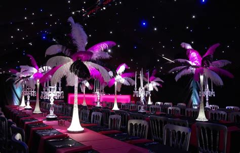 illuminated feather table centres  glass candelabra